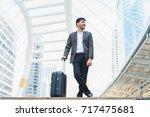business man walking at... | Shutterstock . vector #717475681