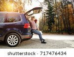 autumn trip of car and two... | Shutterstock . vector #717476434
