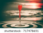 target hit in the center by... | Shutterstock . vector #717478651