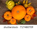 orange raw pumpkins... | Shutterstock . vector #717480709