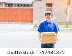 delivery concept   smiling... | Shutterstock . vector #717481375