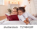 family. mother with daughter in ... | Shutterstock . vector #717484189