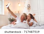 family. mother with daughter in ... | Shutterstock . vector #717487519