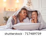 family. mother with daughter in ... | Shutterstock . vector #717489739