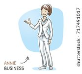 happy young woman in business... | Shutterstock .eps vector #717491017