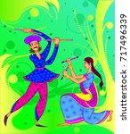 people performing garba dance... | Shutterstock .eps vector #717496339