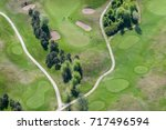aerial view over the golf course | Shutterstock . vector #717496594
