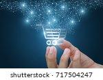 shopping cart as part of the...   Shutterstock . vector #717504247