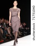 Small photo of NEW YORK - FEBRUARY 14: Model Juju Ivanyuk walks the runway at the Carolina Herrera Fall 2011 Collection presentation during Mercedes-Benz Fashion Week on February 14, 2011 in New York.