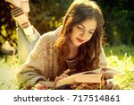 beautiful woman reading book in ... | Shutterstock . vector #717514861