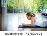 asian woman relaxing with smart ... | Shutterstock . vector #717520825