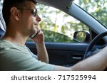 serious man on road trip in... | Shutterstock . vector #717525994