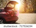 autumn sunset time and car on... | Shutterstock . vector #717526234