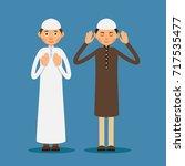 muslim praying. two muslim men... | Shutterstock .eps vector #717535477