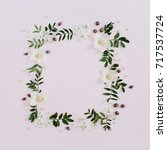 Stock photo frame of flowers branches leaves and petals with space for text on pink background flat lay top 717537724
