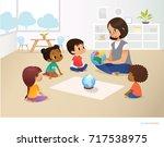 smiling kindergarten teacher... | Shutterstock . vector #717538975
