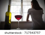 woman drinking wine alcohol... | Shutterstock . vector #717543757