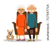 on the sofa sit elderly woman ... | Shutterstock .eps vector #717547714
