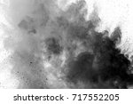 explosion of black powder on... | Shutterstock . vector #717552205