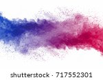 explosion of multicolored dust... | Shutterstock . vector #717552301