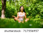 a beautiful young sporty girl...   Shutterstock . vector #717556957