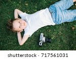 beautiful caucasian little boy... | Shutterstock . vector #717561031