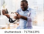 amused african american... | Shutterstock . vector #717561391