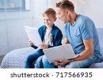little boy looking through...   Shutterstock . vector #717566935
