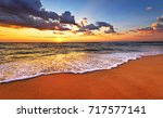 beautiful tropical sunrise on... | Shutterstock . vector #717577141