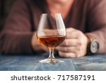 Small photo of Lonely man drink alcohol on kitchen, alcoholism abuse