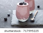 berries smoothie. healthy... | Shutterstock . vector #717595225