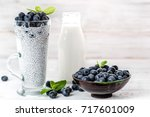 chia pudding with berries and... | Shutterstock . vector #717601009