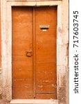 old vintage wooden door in a... | Shutterstock . vector #717603745