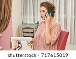 Small photo of Woman holding phone and magazine. Pretty girl in beauty salon. Fashion consultant career.