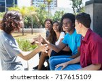 group of african american and... | Shutterstock . vector #717615109