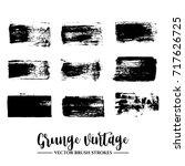 set of black brush stroke and... | Shutterstock .eps vector #717626725