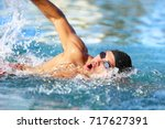 man swimmer swimming crawl in... | Shutterstock . vector #717627391