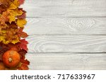Autumn Leaves And Pumpkin Over...