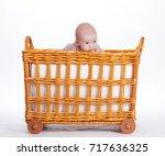 cute newborn baby in the basket | Shutterstock . vector #717636325