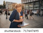 busy woman is in a hurry  she... | Shutterstock . vector #717647695