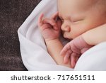 cute newborn baby in the blanket | Shutterstock . vector #717651511