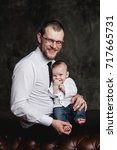 studio portrait of father and... | Shutterstock . vector #717665731
