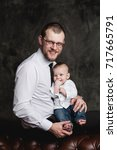 studio portrait of father and... | Shutterstock . vector #717665791