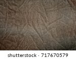 Small photo of Worn old velvet on a silk-based. Short pile, light brown tones. Soft, delicate texture. Inhomogeneous color.