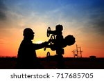 the oil workers are working | Shutterstock . vector #717685705