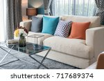 colorful pillows on modern sofa ... | Shutterstock . vector #717689374