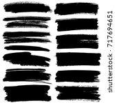 set of black flat brush strokes ... | Shutterstock . vector #717694651