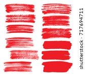 set of red flat brush strokes... | Shutterstock . vector #717694711