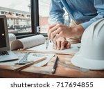 architect working on blueprint  ...   Shutterstock . vector #717694855