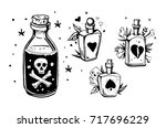 bottles with potions. poison... | Shutterstock .eps vector #717696229